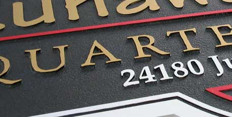 custom sandblasted signs in wood and HDU sign foam